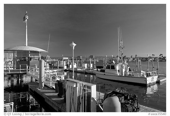 Fishing boat and harbor gas station. Marina Del Rey, Los Angeles, California, USA (black and white)