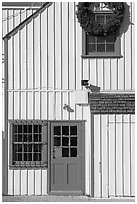 Wooden house with bright blue door. Marina Del Rey, Los Angeles, California, USA (black and white)
