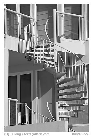 Facade detail of beach house with spiral stairway. Santa Monica, Los Angeles, California, USA (black and white)