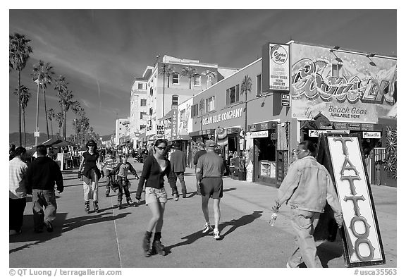 Black and white picture photo rollerblading on ocean front walk venice los angeles california usa