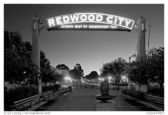 Broadway Street with Best Climate neon sign at dusk. Redwood City,  California, USA (black and white)