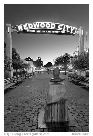 Plaza with Climate Best by Government Test sign at night. Redwood City,  California, USA (black and white)