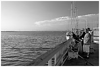 Fishing in the Port of Redwood, late afternoon. Redwood City,  California, USA (black and white)