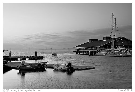 Marina, with small boat comming back to port at sunset. Redwood City,  California, USA (black and white)