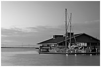 Marina building and yachts, sunset. Redwood City,  California, USA (black and white)
