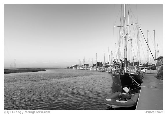 Yachts and Bair Island wetlands, sunset. Redwood City,  California, USA (black and white)