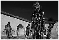 Rodin Burghers of Calais in the Main Quad at night. Stanford University, California, USA (black and white)