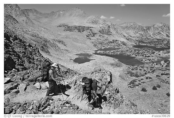 Backpackers descending from Bishop Pass, John Muir Wilderness. California, USA (black and white)