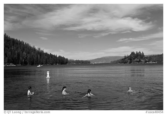 Family in water, Emerald Bay, California. USA (black and white)