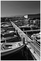 Small boats and dock, Sunnyside marina, Lake Tahoe, California. USA ( black and white)