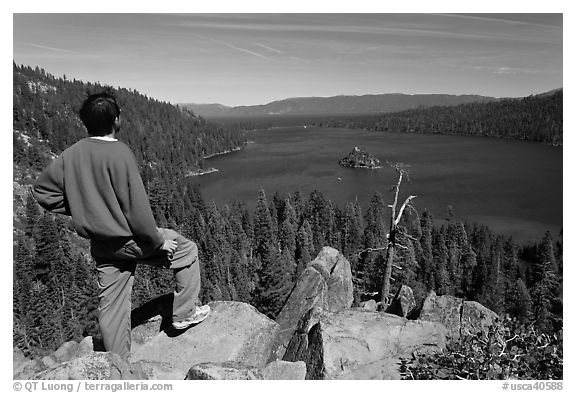 Man standing above Emerald Bay, Lake Tahoe, California. USA (black and white)