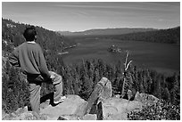 Man standing above Emerald Bay, Lake Tahoe, California. USA ( black and white)
