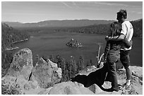 Couple standing above Emerald Bay, Lake Tahoe, California. USA ( black and white)