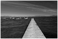 Dock, small boats, and blue waters and mountains, Lake Tahoe, California. USA (black and white)