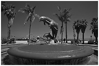 Dolphin fountain and beach. Santa Barbara, California, USA ( black and white)