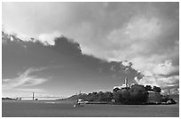Golden Gate Bridge and Alcatraz under large cloud. San Francisco, California, USA (black and white)