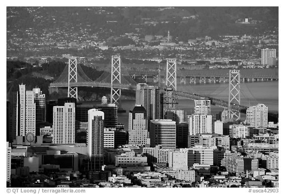San Francisco high-rises, Bay Bridge, Yerba Buena Island, and East Bay. San Francisco, California, USA (black and white)