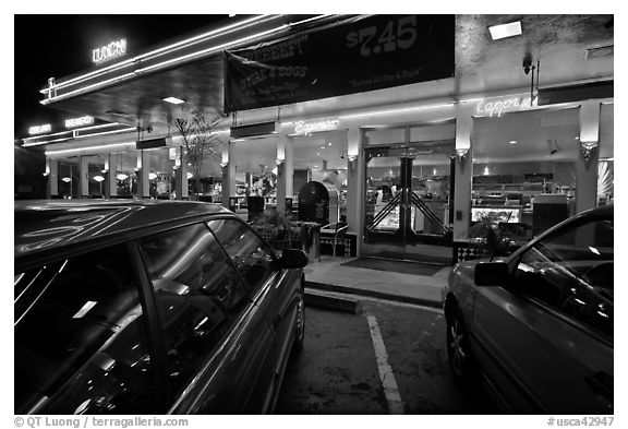 Cars and neon light of dinner at night. San Francisco, California, USA (black and white)