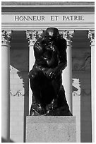 Rodin sculpture The Thinker and Legion of Honor motto in French. San Francisco, California, USA (black and white)