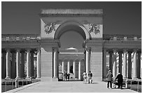 Entrance of  Palace of the Legion of Honor museum with tourists. San Francisco, California, USA (black and white)
