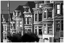 Row of brightly painted Victorian houses, Haight-Ashbury District. San Francisco, California, USA (black and white)