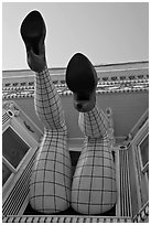 Legs with fishnet stockings hanging from a window, Haight-Ashbury District. San Francisco, California, USA ( black and white)