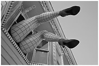 Giant lady legs on Haight street, Haight-Ashbury District. San Francisco, California, USA ( black and white)