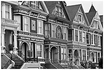 Row of elaborately decorated victorian houses. San Francisco, California, USA ( black and white)