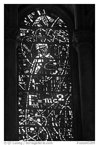Stained glass window with Einstein figure and famous energy equation, Grace Cathedral. San Francisco, California, USA (black and white)