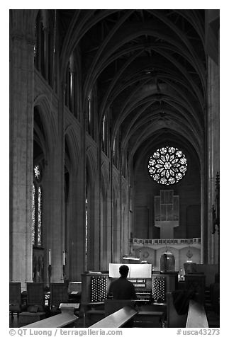 Organist, nave, and rose window, Grace Cathedral. San Francisco, California, USA (black and white)