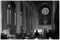 Church organist playing inside Grace Cathedral. San Francisco, California, USA ( black and white)