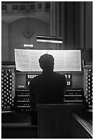Musician playing organ, Grace Cathedral. San Francisco, California, USA ( black and white)