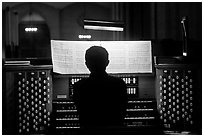 Organist and musical score, Grace Cathedral. San Francisco, California, USA ( black and white)
