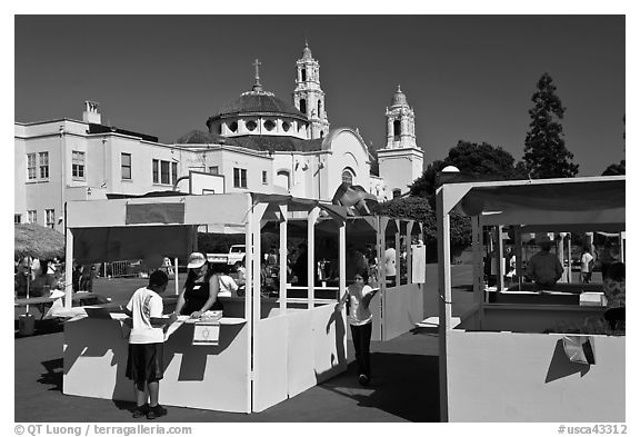 School fair booths and Mission Dolores in the background. San Francisco, California, USA (black and white)