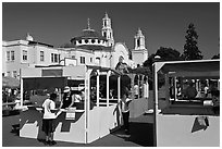 School fair booths and Mission Dolores in the background. San Francisco, California, USA ( black and white)