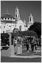 School fair booth, children, and Mission Dolores in the background. San Francisco, California, USA ( black and white)