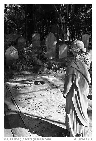 Graves in the garden of Mission San Francisco de Asis. San Francisco, California, USA (black and white)
