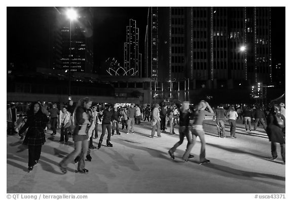 Holiday ice rink at night, Embarcadero Center. San Francisco, California, USA (black and white)