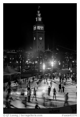 Ice rink and Ferry Building tower at night. San Francisco, California, USA (black and white)