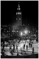 Ice rink and Ferry Building tower at night. San Francisco, California, USA ( black and white)