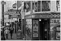 Sidewalk with Vesuvio Cafe, Jack Kerouac street sign, Columbus Tower, and Transamerica Pyramid, North Beach. San Francisco, California, USA ( black and white)