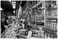 Italian grocery store interior with customers, Little Italy, North Beach. San Francisco, California, USA (black and white)