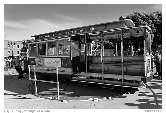 Cable car being turned at terminus. San Francisco, California, USA (black and white)
