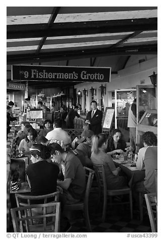 Outdoor terrace of seafood restaurant, Fishermans wharf. San Francisco, California, USA (black and white)
