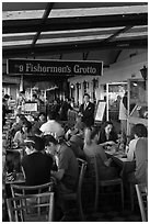 Outdoor terrace of seafood restaurant, Fishermans wharf. San Francisco, California, USA ( black and white)