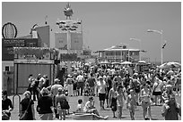 Summer crowds on Santa Monica Pier. Santa Monica, Los Angeles, California, USA (black and white)