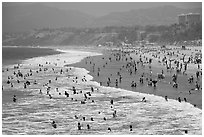 Many people bathing in surf at Santa Monica Beach. Santa Monica, Los Angeles, California, USA (black and white)
