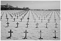 Memorial to fallen soldiers and Santa Monica Pier. Santa Monica, Los Angeles, California, USA (black and white)