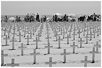 Crosses and beachgoers. Santa Monica, Los Angeles, California, USA (black and white)