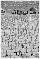 War memorial and families at edge of water on beach. Santa Monica, Los Angeles, California, USA (black and white)